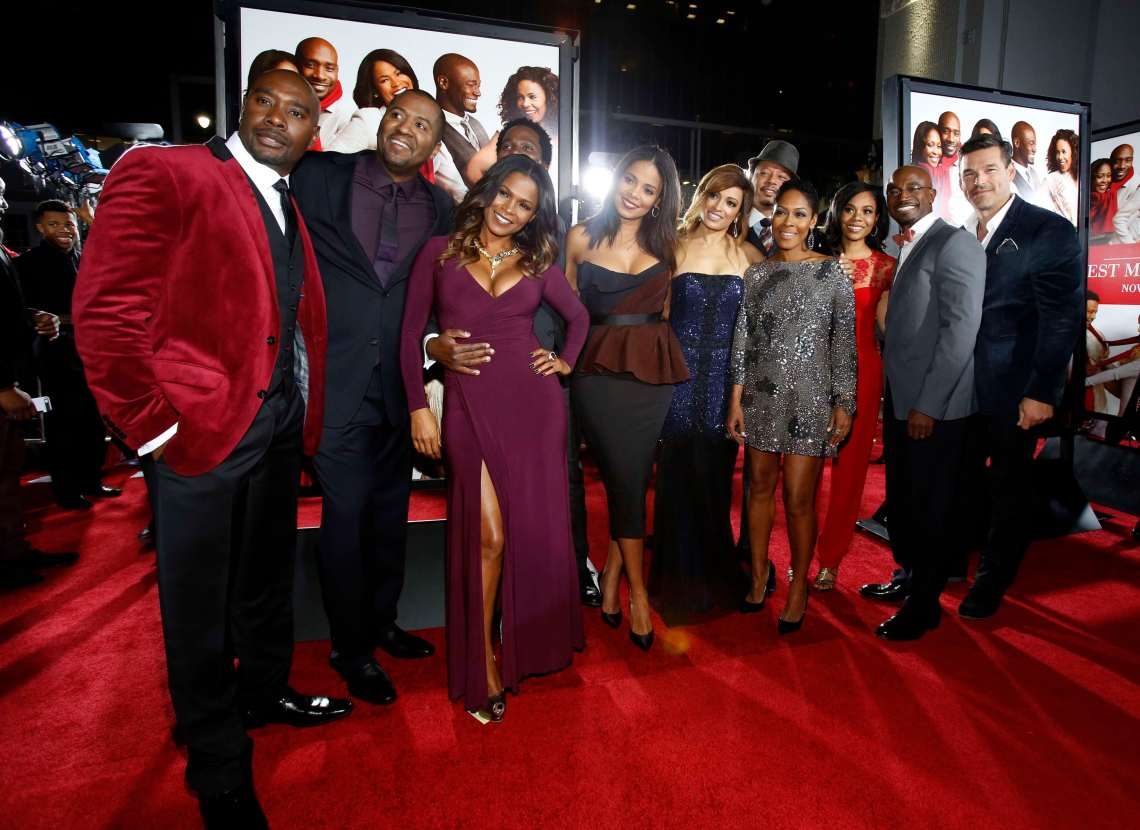 """Lee poses with cast members Chestnut, Long, Perrineau, Lathan, De Sousa, Howard, Calhoun, Hall, Diggs and Cibrian at the premiere of """"The Best Man Holiday"""" in Hollywood"""