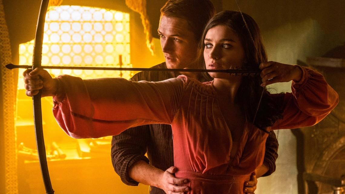 Eve-Hewson-Taron-Egerton-in-Robin-Hood-2018.jpg